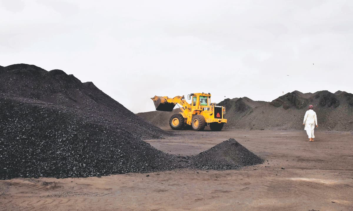 Coal being unloaded from a truck in Karachi    Fahim Siddiqui, White Star