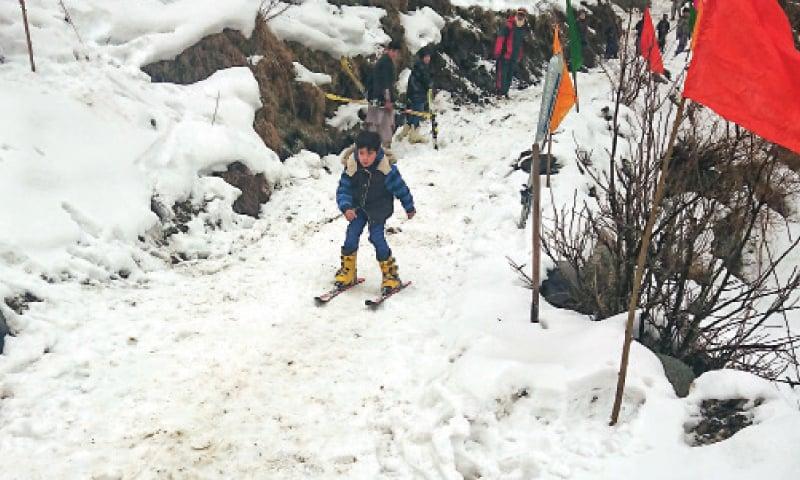 A boy skis down the slope in Gabin Jabba, Swat. — Dawn