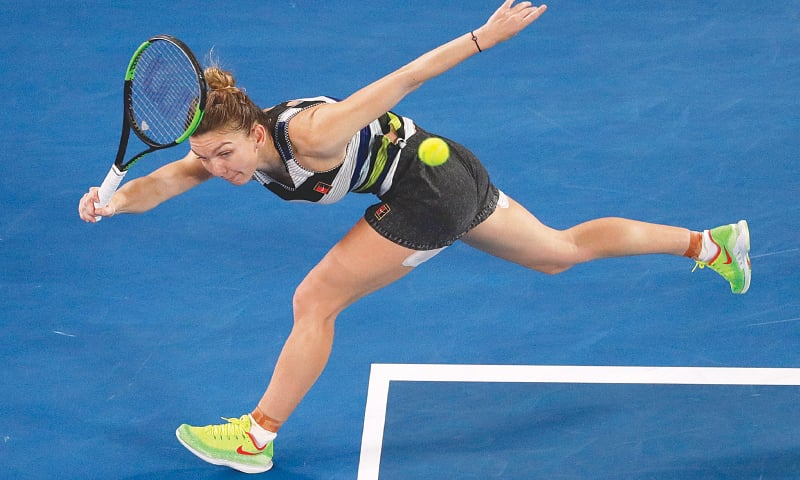 ROMANIA'S Simona Halep makes a forehand return to Serena Williams of the US during their Australian Open match on Monday.—AP
