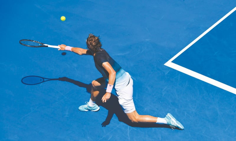 MELBOURNE: Germany's Alexander Zverev hits a return against Milos Raonic of Canada during their match at the Australian Open on Monday.—AFP
