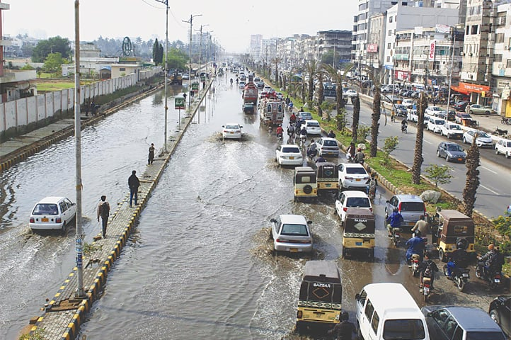 THE arterial University Road is flooded on Monday. —White Star