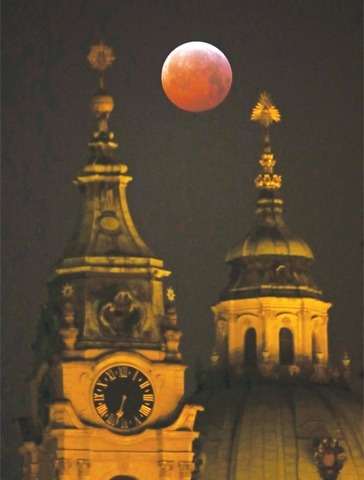 PRAGUE (Czech Republic): A view of the moon during a total eclipse on Monday. An unusual set of celestial circumstances came together on Sunday night and the wee hours of Monday morning to produce the 'super blood wolf moon' for sky watchers in Europe, Africa and the Americas. The full moon was fully obscured before lighting up again with a faint red glow. The moon appeared bigger than normal because it was closer to the Earth — about 358,000 kilometres away instead of the usual 390,000km — earning it the nickname 'super moon'. The moniker 'wolf moon' was given because it appeared in January, when hungry wolves would howl outside villages in days gone by.—Reuters