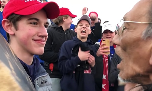 Video of Nick Sandmann standing face to face with an Native American Indian activist has sparked outrage. — Online