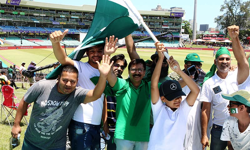 Pakistani fans wave flags ahead of the start of the match. — AFP