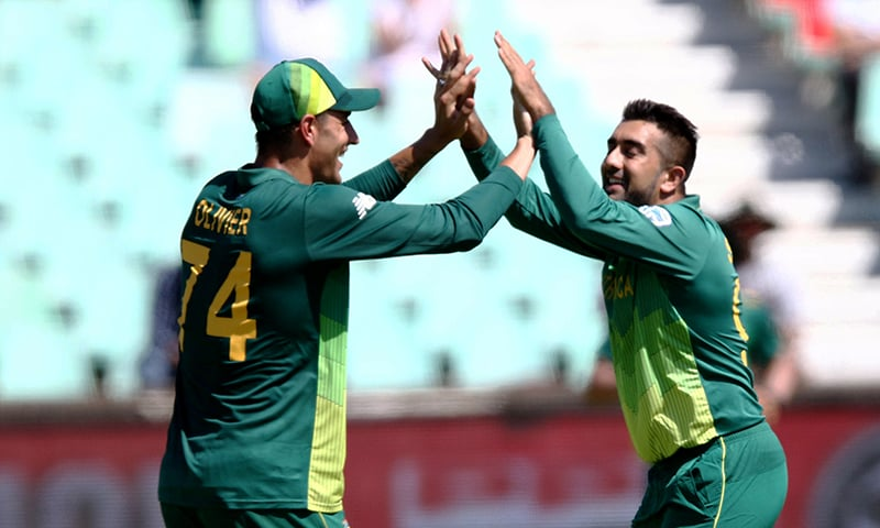 Tabraiz Shamsi (R) and Duane Olivier of South Africa celebrate a wicket. — AFP