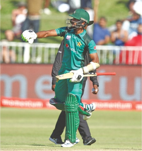 DURBAN: Hasan Ali punches the air in jubilation after completing a half century during the second one-day international against South Africa on Tuesday.—AFP