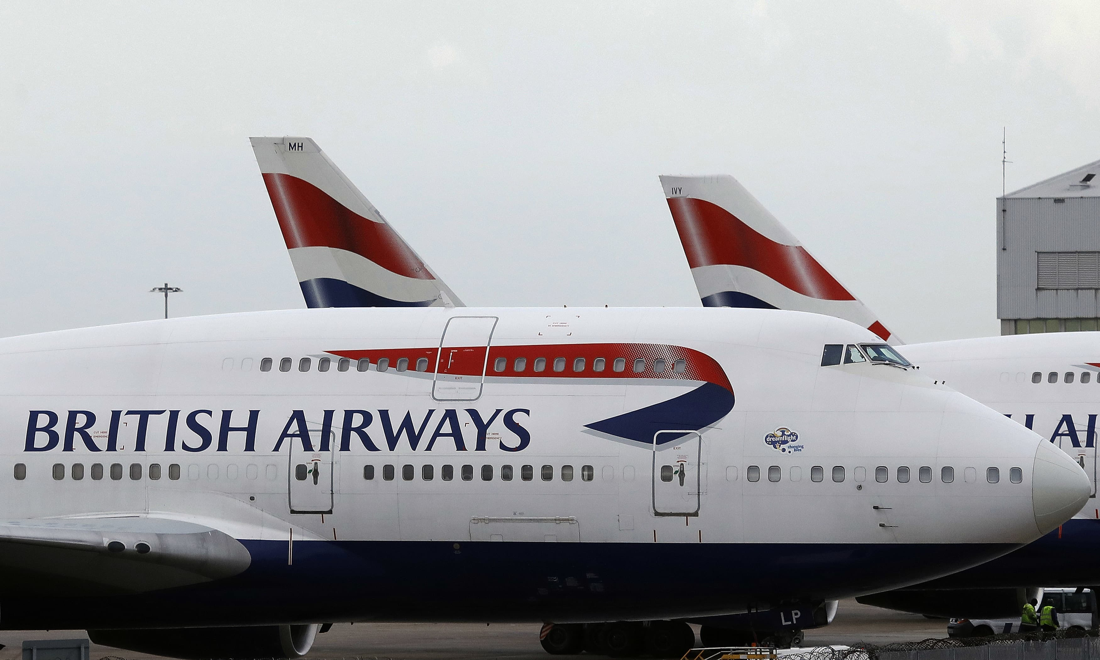 British Airways planes are parked at Heathrow Airport in London. —AP/File