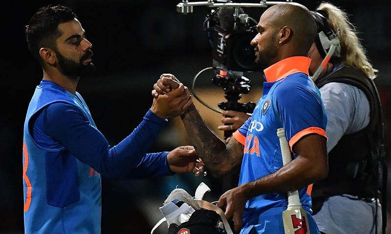 India's Shikhar Dhawan (R) and captain Virat Kohli celebrate their win in the first one-day international cricket match between New Zealand and India at McLean Park in Napier on January 23, 2019. — AFP