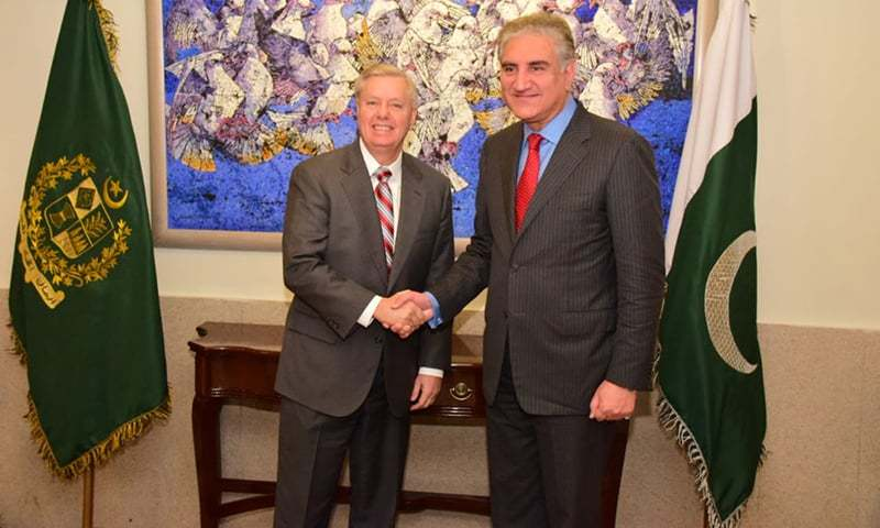US Senator Lindsay Graham shakes hands with Foreign Minister Shah Mehmood Qureshi during his visit to Pakistan. — File photo