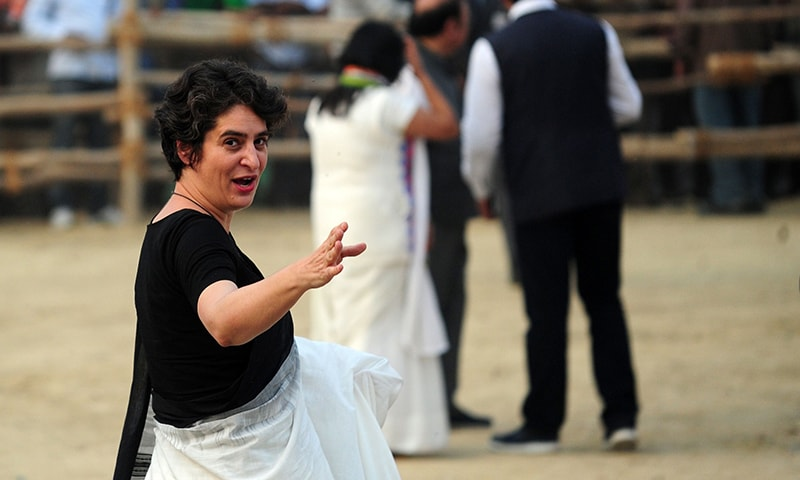 Indian Congress Party leader Priyanka Gandhi waves as she arrives at a rally held to support party candidates during the ongoing Uttar Pradesh state assembly elections at Rae Bareli. — AFP