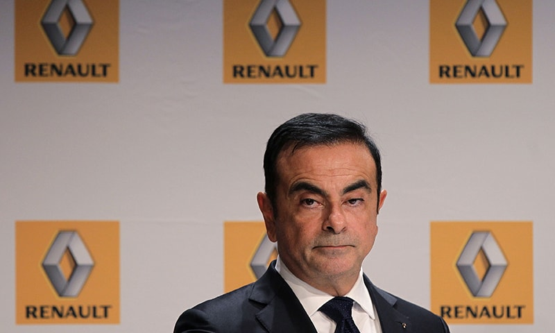 This file photo taken on September 30, 2014 shows French Renault car maker CEO Carlos Ghosn giving a press conference during the inauguration of a new production plant in Sandouville. — AFP