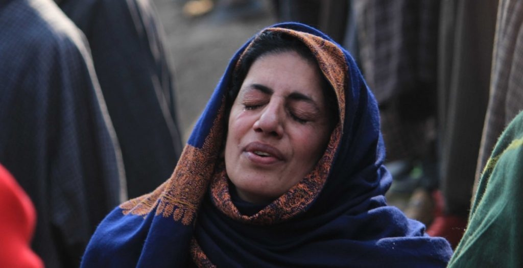 A woman grieves on the death of Firdous Ahmad, a local rebel who was killed during a gunfight in Balpora village of South Kashmir's Shopian district on January 25, 2018. Women in Kashmir bear the brunt since the separatist uprising broke out in the region in 1989