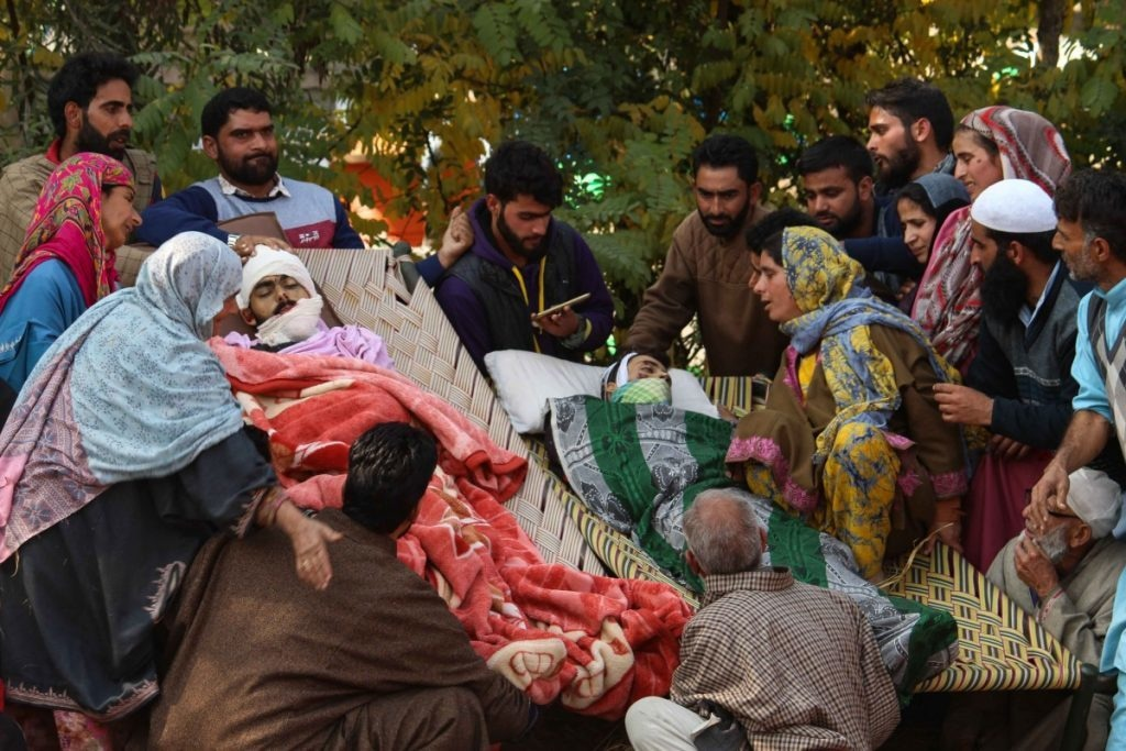 Relatives surround the bodies of two civilians, Talib and Mukeem, in Laroo village of Kulgam on October 21, 2018. Talib and Mukeem, two teenagers from the same village, were among the six civilians who had thronged to an encounter site and were killed when a shell exploded there