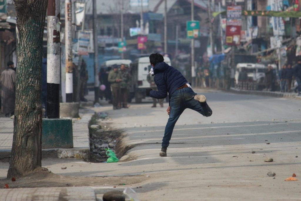 A Kashmiri protester throws stones at Indian police and paramilitary forces. Stone pelting has now become a common trend in Kashmir