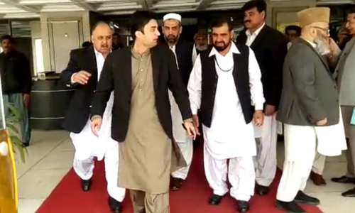 Firebrand Communications Minister Murad Saeed responds to the opposition's noisy protest during the finance minister's budget speech. ─ File photo