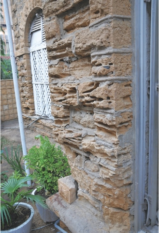 Wall with damaged stones telling a tale of neglect | Aziz Soomro / EFT