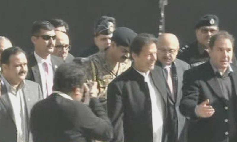 PM Khan was received by CM Buzdar and the college's management upon his arrival in his hometown. — DawnNewsTV