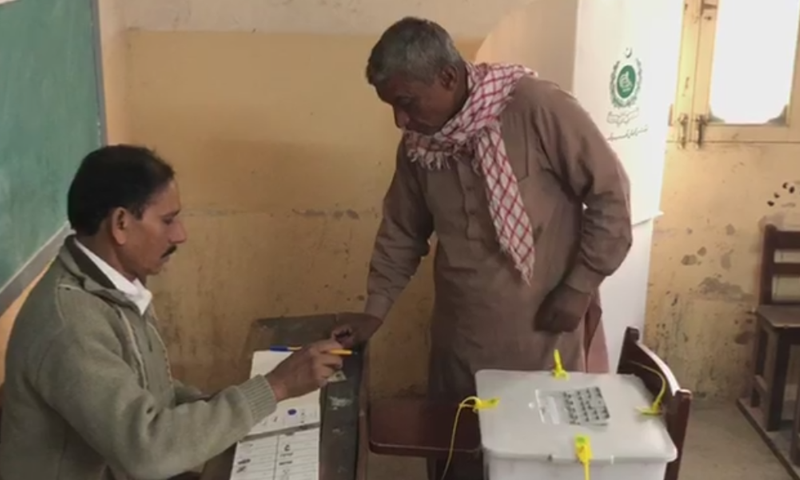 A voter casts his vote during the PS-94 by-poll in Karachi's Korangi area on Sunday. — DawnNewsTV
