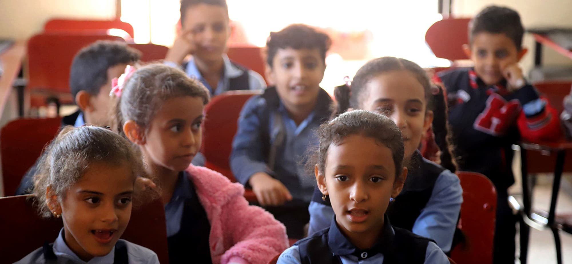 Children attend a music class at the Al-Nawras school in Taez, Yemen's third city, in the country's southwest, on January 23, 2019. - The three-storey Al-Nawras school was hit in 2015-2016, right after Saudi Arabia and its allies joined the government's fight against the Huthis. When it reopened its doors, walls still pockmarked with bullet holes, educators decided to expand the music programme, making it part of the core curriculum alongside maths and Arabic, with the hope that it would restore joy to their students' days. (Photo by AHMAD AL-BASHA / AFP) — AFP or licensors