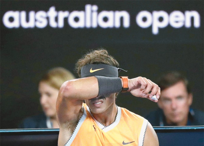 SPAIN'S Rafael Nadal grimaces during a break in the final.—AP