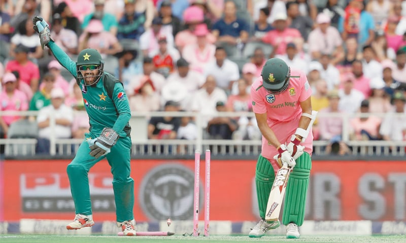 JOHANNESBURG: Pakistan wicket-keeper Mohammad Rizwan celebrates after South African opener Hashim Amla is bowled during the fourth One-day International at the Wanderers on Sunday.—AP