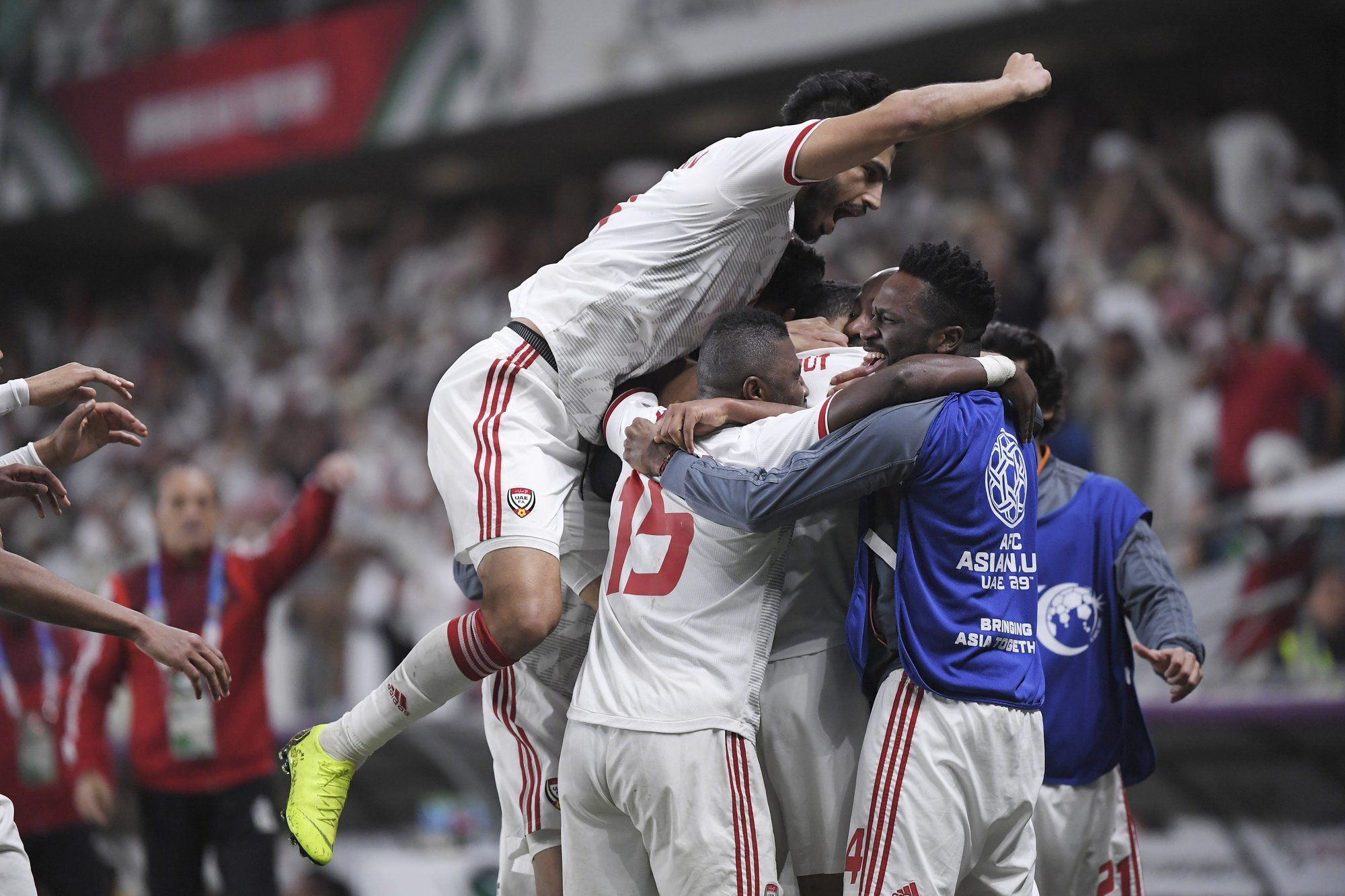 UAE players celebrate a goal during the AFC Asian Cup quarterfinal soccer match with Australia at Hazza Bin Zayed Stadium in Al Ain on Jan 25. — AP
