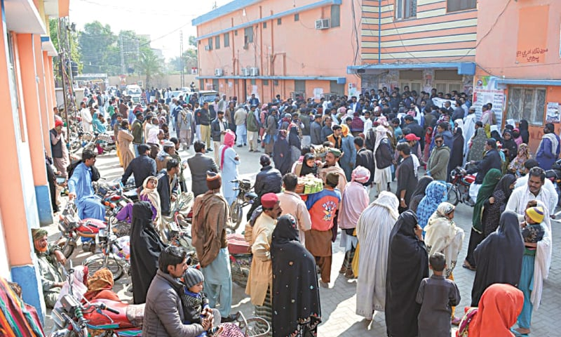 PATIENTS and their attendants helplessly stay outside the CMCH complex during a Sindh-wide strike by young doctors on Monday.—Dawn