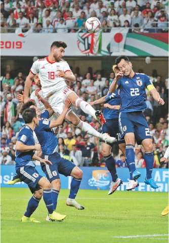 ABU DHABI: Iran's Alireza Jahanbakhsh (C) heads the ball during the Asian Cup semi-final against Japan at the Hazza Bin Zayed Stadium on Monday.—AFP