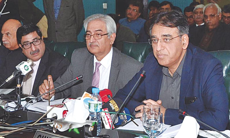 FEDERAL Minister for Finance, Revenue and Economic Affairs  Asad Umer talking to media.—INP