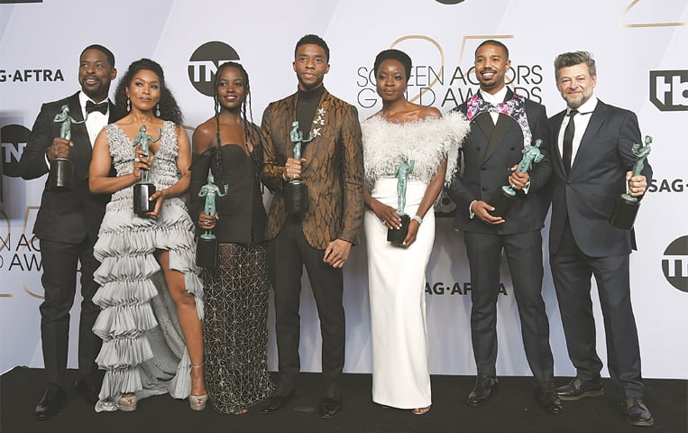 LOS ANGELES: The cast of Black Panther pose with their awards at the annual Screen Actors Guild Awards on Monday.—AP