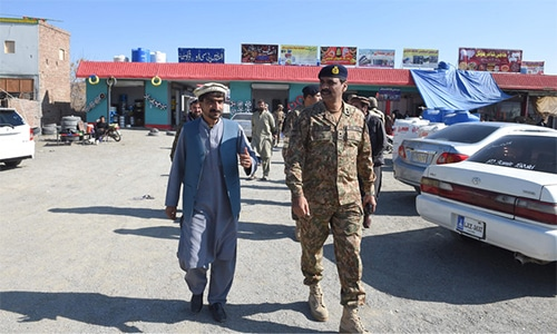 Pakistan army spokesperson Major General Asif Ghafoor visits a market in Miran Shah, a town in North Waziristan, near the border between Pakistan and Afghanistan. — AFP/File
