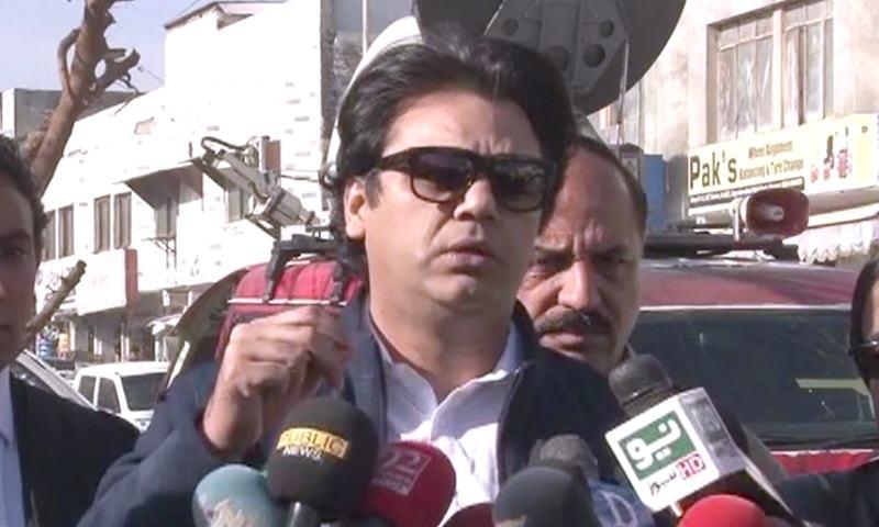Usman Dar speaks to media outside the Islamabad High Court on Tuesday. — DawnNewsTV