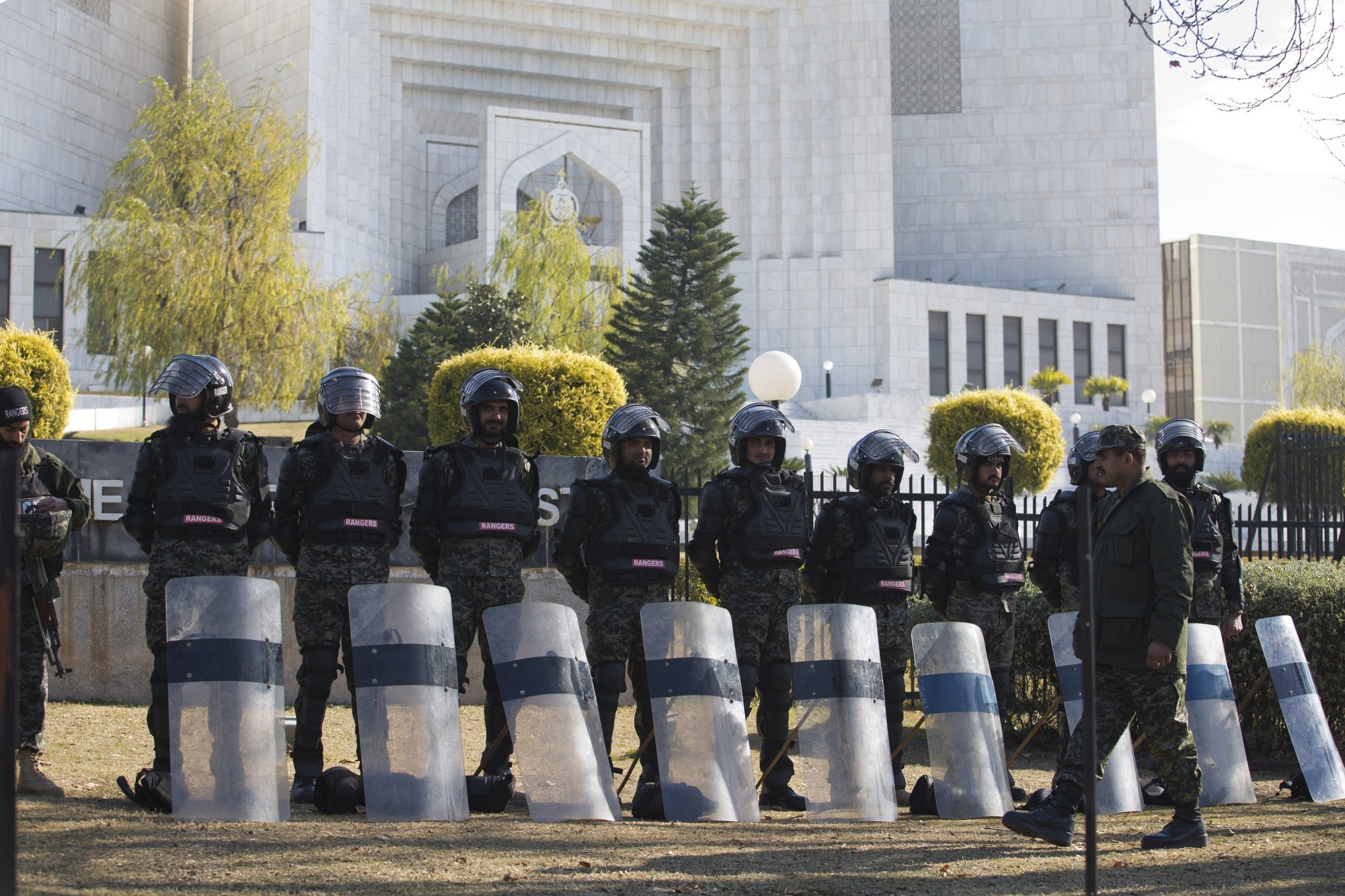 Law enforcers surround the Supreme Court building on Tuesday as security is beefed up during the hearing of petition against Aasia Bibi's acquittal. — AP