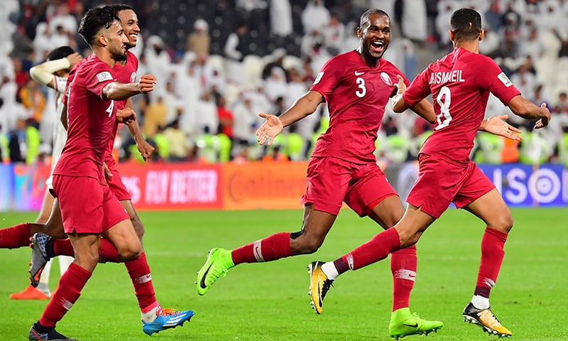Qatar's defender Hamid Ismeil (R) celebrates his goal during the 2019 AFC Asian Cup semi-final football match between Qatar and UAE at the Mohammed Bin Zayed Stadium in Abu Dhabi on January 29, 2019. — AFP