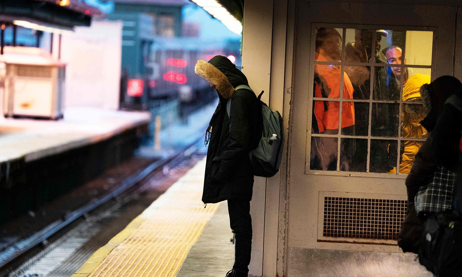 A young man waits on a subway platform in freezing temperatures on January 30, 2019 in New York. — AFP