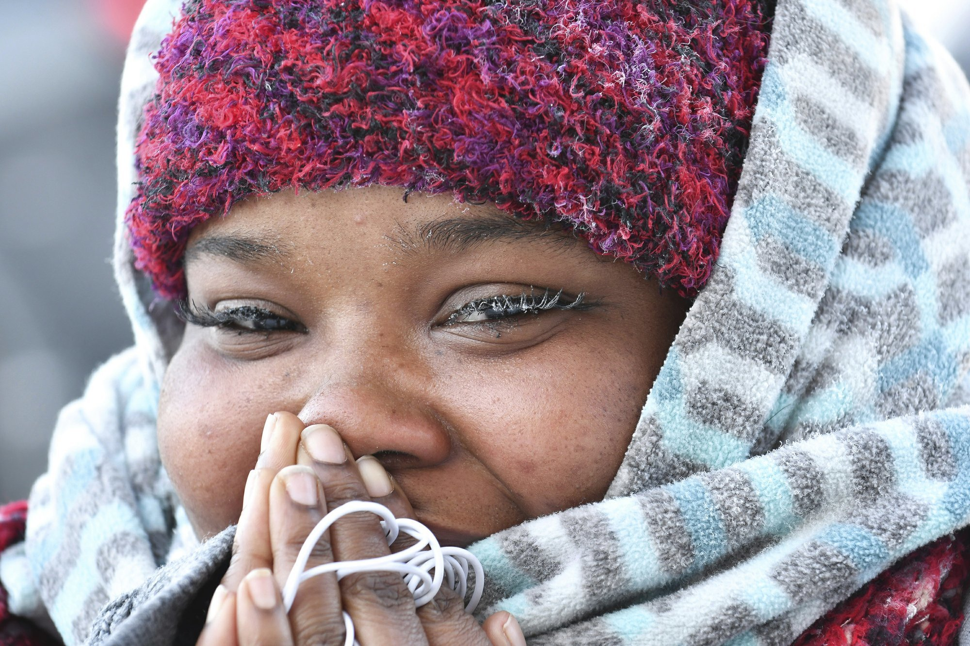 Ice forms on the eyelashes of Aubreyanne Edwards, of Rock Island, Ill., as she braves minus 27 windchill. — AP