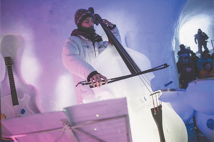 PASSO TONALE (Italy): A musician performs with a double bass made from ice during a concert on Presena glacier.—AFP
