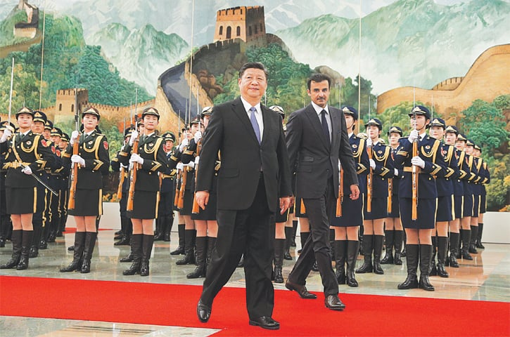 Beijing: Qatari Emir Sheikh Tamim bin Hamad Al Thani (right) and Chinese President Xi Jinping review an honour guard on Thursday.—AP