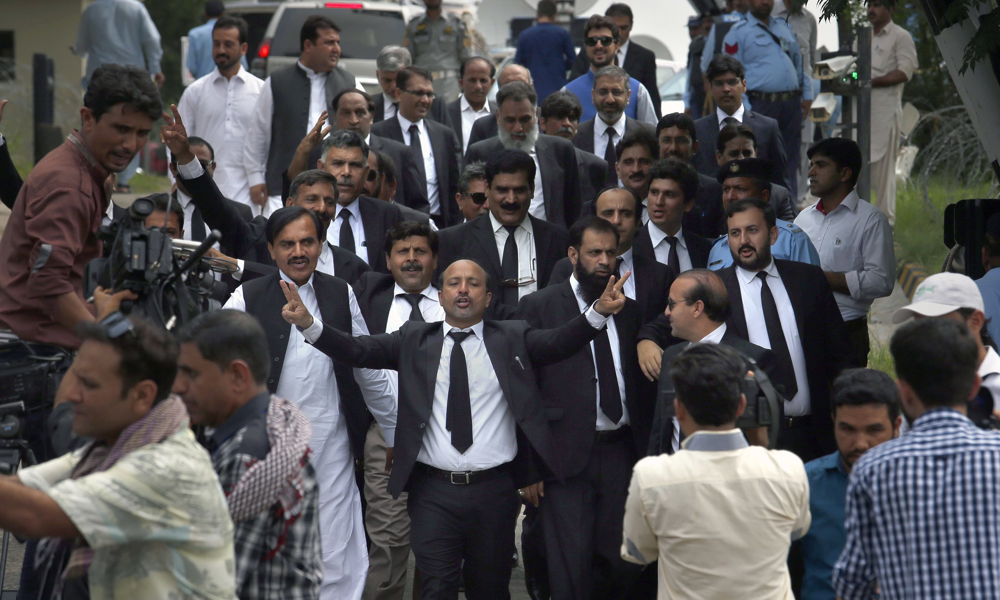 "COVER - Lawyers shout ""go Nawaz go"" after leaving the Supreme Court following proceedings on corruption allegations against Prime Minister Nawaz Sharif's family, in Islamabad, Pakistan, Monday, July 17, 2017. The lawyers for opposition parties requested the court disqualify Sharif as he did not deserve to remain in power after a probe found that the premier and his family possessed wealth beyond their known sources of income. The court is expected to rule on the petitions in the coming weeks. (AP Photo/Anjum Naveed) — Copyright 2017 The Associated Press. All rights reserved."