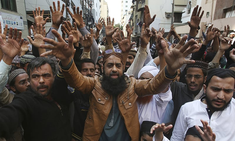 Supporters of TLP rally to condemn the Supreme Court's decision to uphold the acquittal of Christian woman Aasia Bibi, in Karachi. — AP