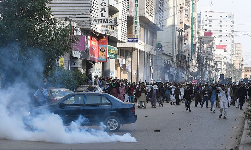 TLP workers march to protest against the Supreme Court decision in Karachi on Friday. — AFP