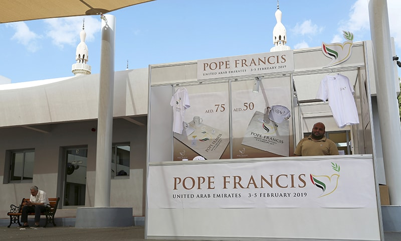 In this January 20, 2019, file photo, a man sells memorabilia for Pope Francis' upcoming trip to the United Arab Emirates at St. Mary's Catholic Church in Dubai, United Arab Emirates.  — AP