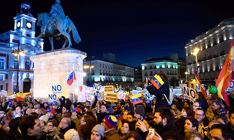 People demonstrate on February 2, 2019 in Madrid to back Venezuelan self-proclaimed acting president Juan Guaido´ s call for early elections as international pressure increased on President Nicolas Maduro to step down. — AFP