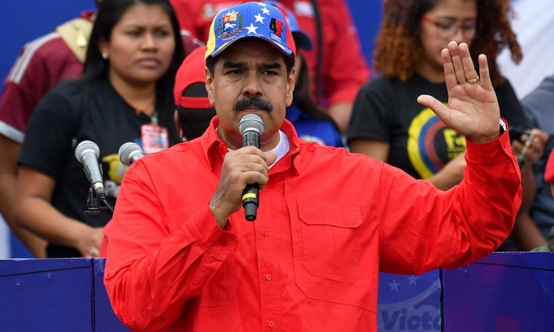 Venezuelan President Nicolas Maduro delivers a speech during a gathering with supporters to mark the 20th anniversary of the rise of power of the late Hugo Chavez, on Feb 2, 2019. — AFP