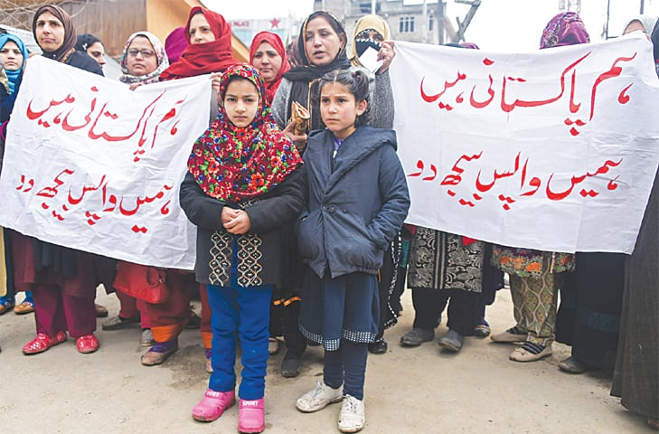 SRINAGAR: A group of Pakistani women married to former Kashmiri fighters take part in a protest on Saturday to urge Indian and Pakistani prime ministers to allow them to return to Pakistan.—AFP