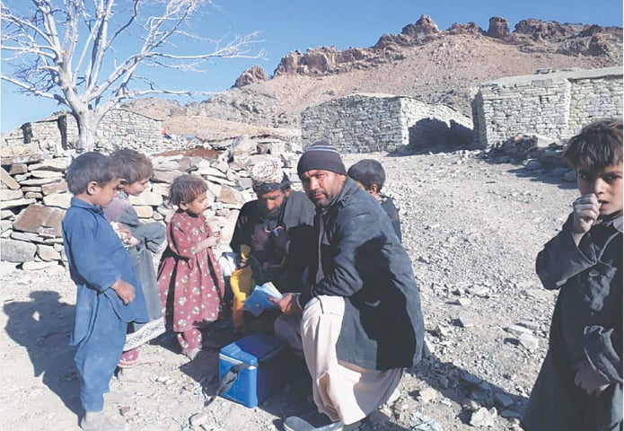 Health workers perform their duty in Zhob, which has been declared a high-risk division