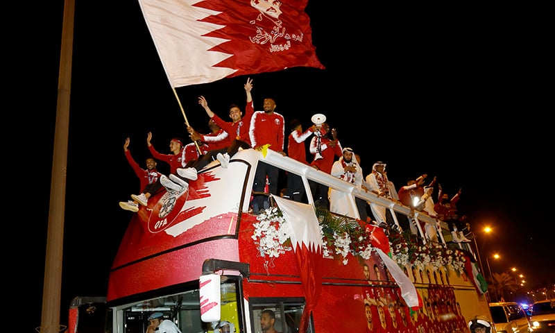 Qatari national football team players and staff celebrate at Doha Corniche in Doha on February 2, 2019, as they come back from the United Arab Emirates with the trophy after winning the 2019 AFC Asian Cup football tournament. ─ AFP