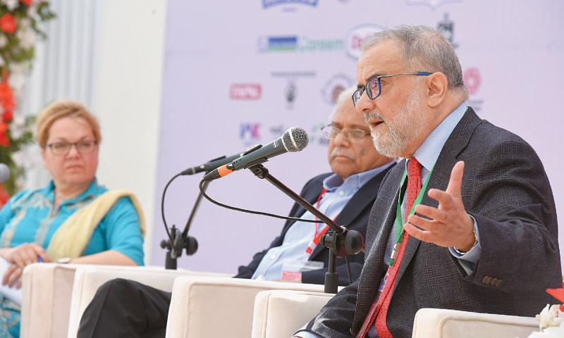 KARACHI: Ahmed Rashid speaks at the Adab Festival on Sunday as Zahid Hussain and Fatemah Aman look on. —Tahir Jamal / White Star