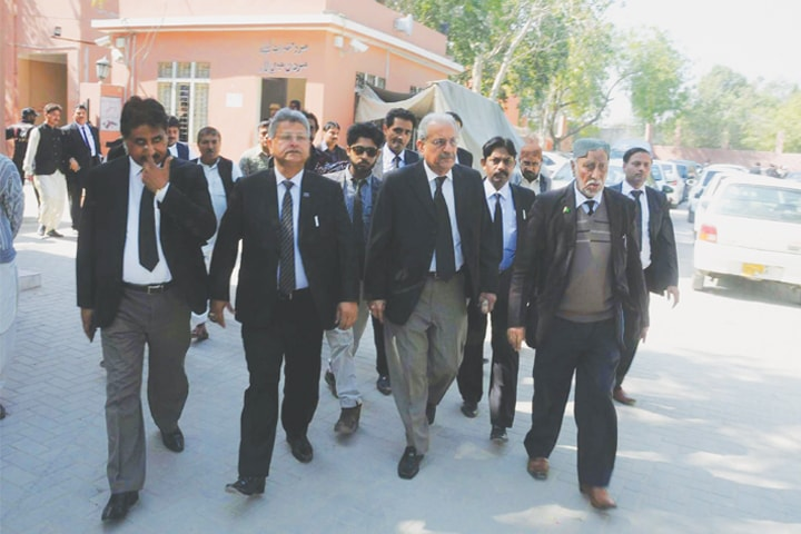PPP leader Mian Raza Rabbani visits the Sindh High Court building along with lawyers in Hyderabad on Monday.—Dawn