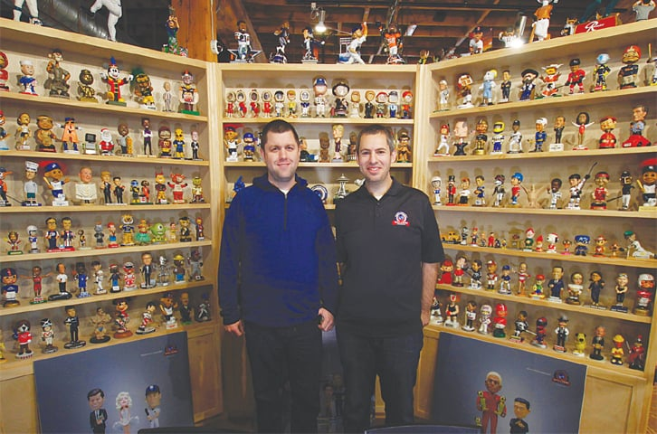 MILWAUKEE (USA): Founders of the National Bobblehead Hall of Fame and Museum Brad Novak (left) and Phil Sklar stand near the museum's entrance.—AP